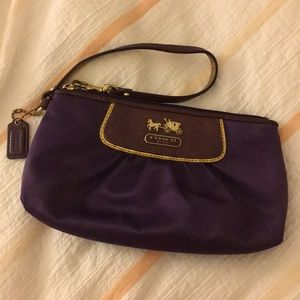 Large purple satin Coach wristlet